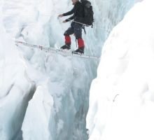 Paul crossing the first ladder in the Everest icefall