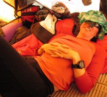 Fiona resting at camp 2 using a bandana to shield her eyes from the bright light