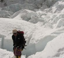 Dasona after crossing a small crevasse in the Everest icefall