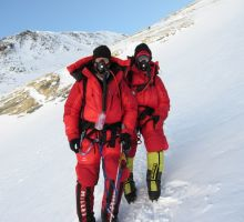 Paul and Fiona Adler climbing Everest with the Yellow Band behind us