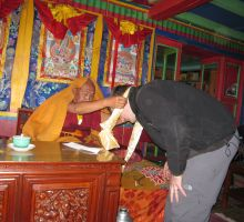 Paul receiving a kata as a blessing in one of the temples
