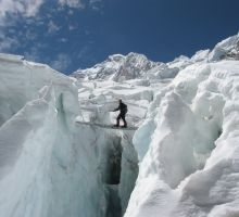 Paul crossing a ladder in the icefall