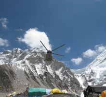 A helicopter taking off from Everest basecamp