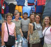 Marg, Cas (behind), Liz, the shopkeeper, Fiona, Julia and Denise shopping for gear in Kathmandu