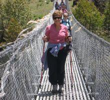 Margaret Harrington crossing one of many swing bridges on the way to Everest Basecamp