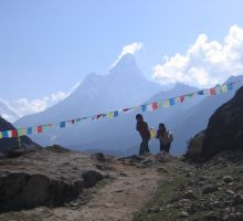 Sherpa people carrying their loads