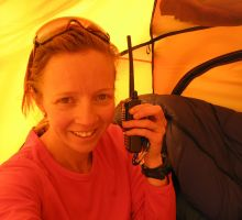 Fiona on the Thuraya satellite phone while Paul is up at the high camps