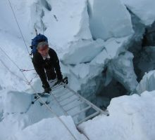Dan crossing a ladder in the icefall