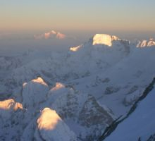 The sun hitting some of the nearby peaks as seen from Everest