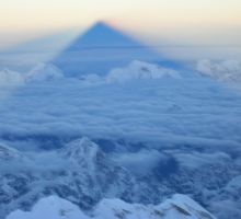 The shadow of Mt Everest on the clouds below