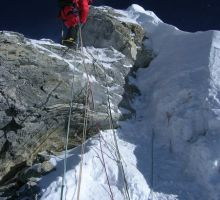 A climber on top of Hilary's Step on Everest