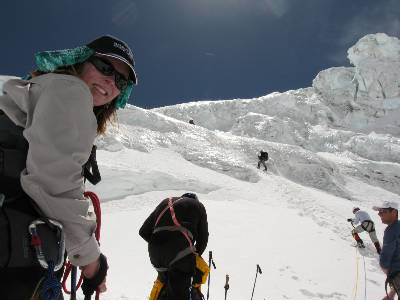 Fiona at the bottom of the Lhotse face. Climbers on the right hand side are starting up the fixed ropes. Photo Paul Adler.