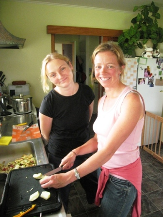 Kyna and Fiona cutting up apples that we had collected from their tree. Photo Paul Adler