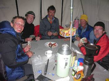 Playing cards in our dining tent after dinner. From left, Paul, Markus, Karl, Walker & Jim. Photo Fiona Adler.