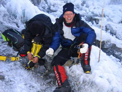 Paul putting his crampons on before heading up the icefall for what is hopefully the last time. Photo Fiona Adler