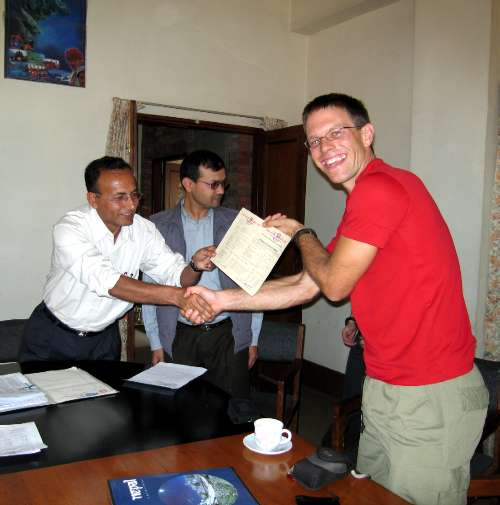 Paul is handed his expedition's climbing permit from the Under Secretary to the Minister for Tourism. Photo Tim Adler.
